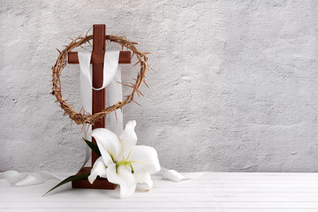 Wall Mural - Composition with crown of thorns, wooden cross and lily on light background