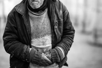 homeless man sleeping on the street