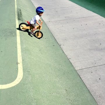 Boy Riding Bicycle In Park