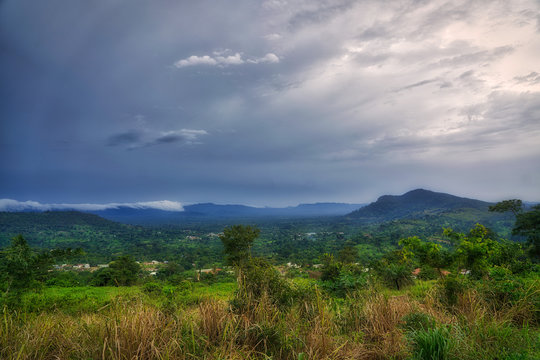 Clouds gather above the hills and rain forest of sub-saharan West Africa in the bush of Ghana.