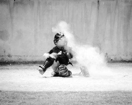 Boy Playing Baseball On Playing Field