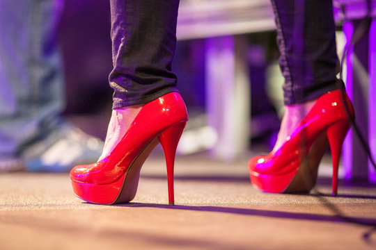 Low Section Of Woman Wearing Red High Heels
