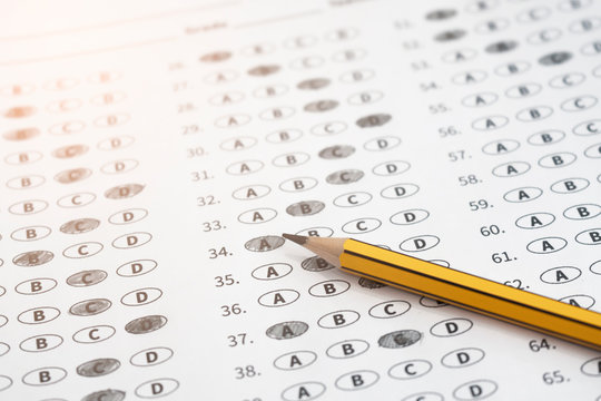 2b pencil and exam paper, school college university testing grade mock exam in further education program, using selective question method test, concept of education system, close up copy space layout