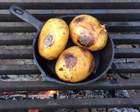 High Angle View Of Potatoes Being Grilled On Barbecue