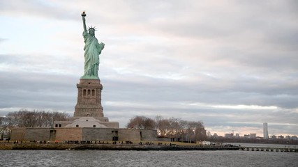 Wall Mural - The Statue of Liberty as seen from a moving boat on the Hudson River
