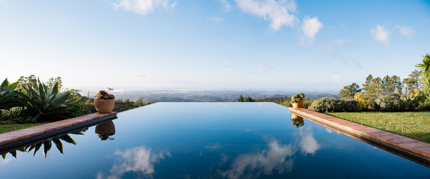 Panoramic View Of Infinity Pool Against Landscape