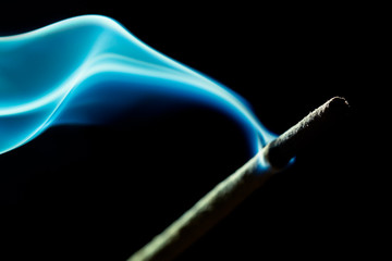 Abstract Image Of Smoke Coming Out From Incense Stick On Black Background