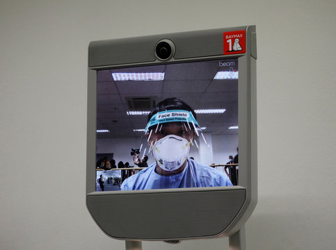 """A """"telepresence"""" robot which provides face-to-face medical consultation is pictured at Changi Exhibition Centre which has been repurposed into a community isolation facility, in Singapore"""