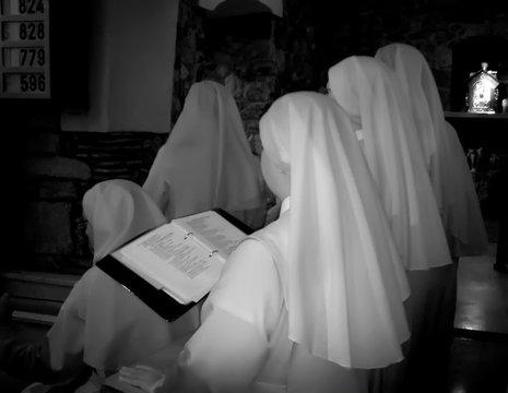Nuns Reading Bible At Church