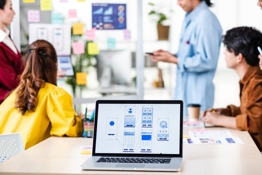 ux developer and ui designer presenting  and testing mobile app interface design on whiteboard in meeting at modern office.Creative digital development mobile app agency