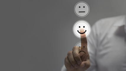 Wall Mural -   Businessman pressing smiley face emoticon on virtual touch screen. Customer service evaluation concept.