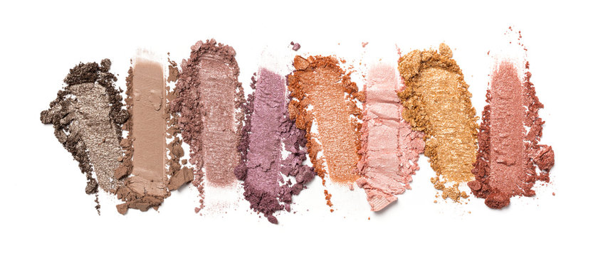 Close-up of make-up swatch. Smear of crushed multicolored set eye shadow
