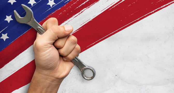 wrench in hand workers. flag USA background design for happy labor day. space for text