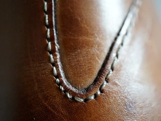 Macro View Of Leather With Stitch