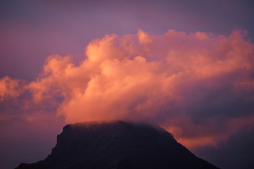 Foto auf AluDibond Hochrote Coloured purple violet sunset at the muntain with white clouds above - beautiful mounts landscape with amazing colors - concept of nature and outdoors
