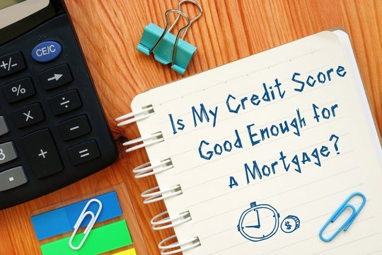 Financial concept about Is My Credit Score Good Enough for a Mortgage? with sign on the sheet.