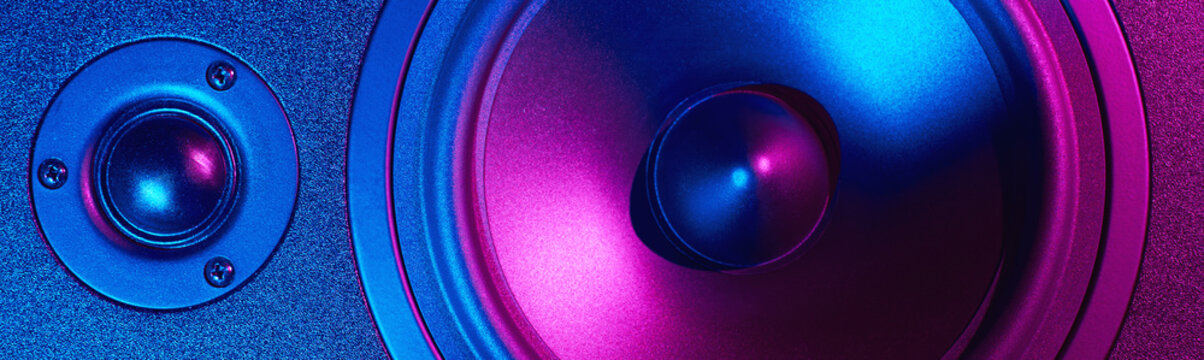 Sound audio speaker with neon lights, long banner. Dynamic monitor close up. Creative backgroound