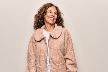 Wall Mural - Middle age beautiful woman wearing casual jacket standing over isolated white background looking to side, relax profile pose with natural face and confident smile.