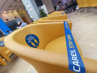 Customer service seating area is seen with messages advising visitors to maintain social distance in a local bank, following the outbreak of the coronavirus disease (COVID-19), in Manama