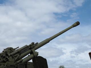 Soviet anti-aircraft gun on blue sky background. 100 mm air defense gun KS-19