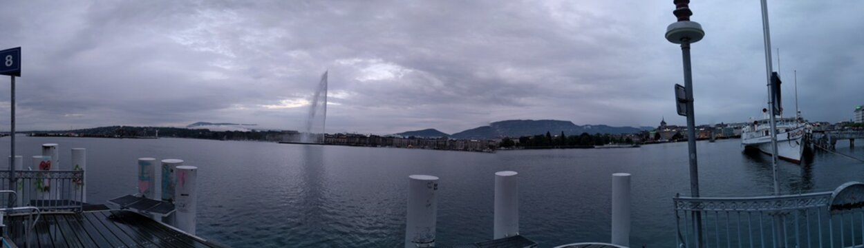 Distant View Of Jet Deau Fountain In Geneva Against Cloudy Sky