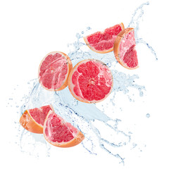 Fototapete - grapefruit slices in water splash isolated on a white background