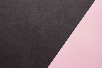 Pink and textured black paper background. Abstract banner, poster with place for text. Minimalism