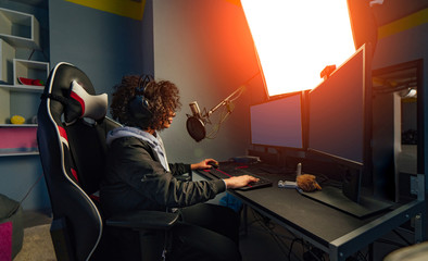 Gamer girl playing in online video game on personal computer. eSport cyber games internet.