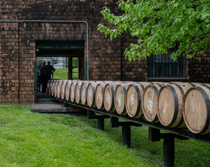 Fototapete - Barrels Roll Through Building