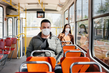 Passengers on public transport during the coronavirus pandemic keep their distance from each other. Protection and prevention covid 19