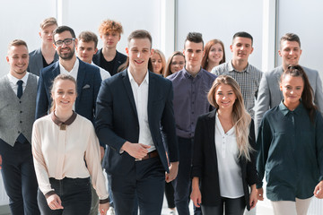 group of ambitious young people walking in a new office