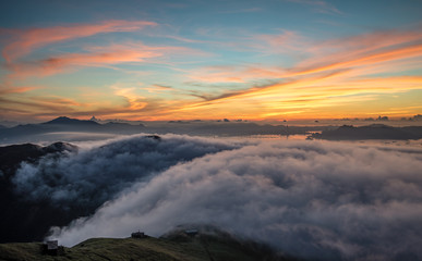 Obraz Scenic View Of Clouds Covered Mountains At Sunset - fototapety do salonu