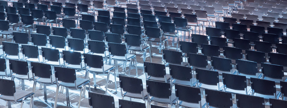 Empty seats. Equipped conference hall. Indoor business conference. Interior of a congress hall. Cancelled meetings, lectures, lessons, forums due to global disease. Online event. Web conference.