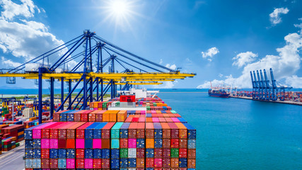 Container ship unloading in deep sea port, Global business logistic import export freight shipping transportation oversea worldwide by container ship open sea, Container vessel loading cargo freight.