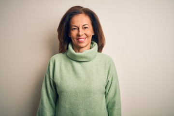 Wall Mural - Middle age beautiful woman wearing casual turtleneck sweater over isolated white background with a happy and cool smile on face. Lucky person.