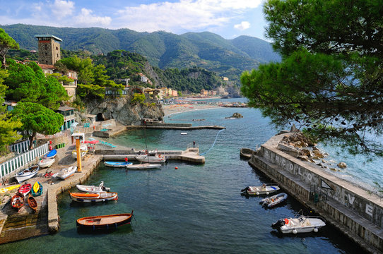 Boats Moored At Harbor By Monterosso Al Mare Town Against Mountains