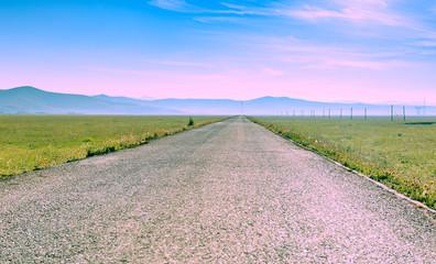 Foto auf Gartenposter Flieder Road Amidst Landscape Against Sky
