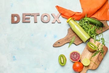 Fotobehang - Healthy smoothie with ingredients and word DETOX on table