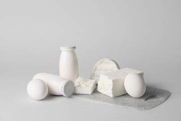 Fotobehang - Different dairy products without lactose on grey background