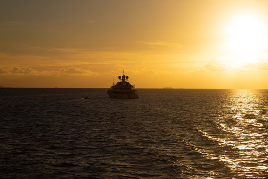 Sunset on the sea with cruise boat Fiji holiday