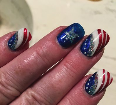Cropped Hand Of Woman With American Flag Nail Art