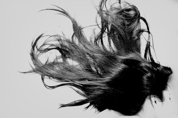 Obraz Side View Of Woman With Long Black Hair Over White Background - fototapety do salonu
