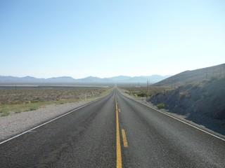 Foto auf Gartenposter Dunkelgrau Empty Road Along Countryside Landscape
