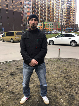 Ibragim Artykov, builder from Tajikistan, poses for a picture during an interview in Moscow