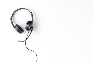 Helpdesk headphones on white background with copyspace
