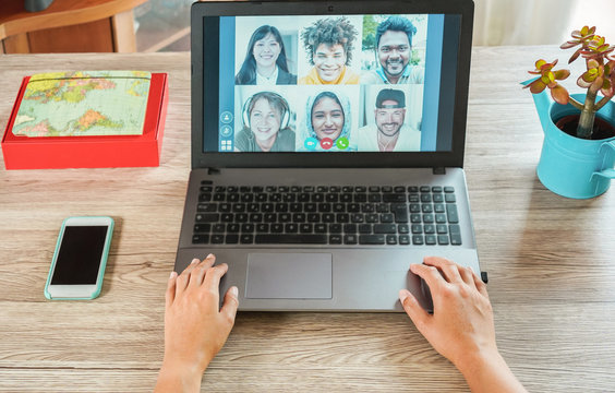 Woman teacher having a video call with multiracial students during isolation quarantine - Group of people chatting online - Technology, school and friends concept - Focus on hands