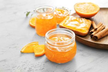 Fotobehang - Jar of orange jam on white background