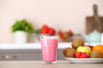 Fotobehang - Glass of healthy smoothie and ingredients on kitchen table
