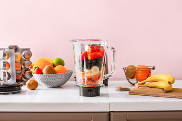 Fotobehang - Modern blender and ingredients for healthy smoothie on kitchen table