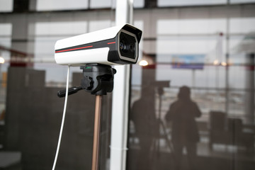 Thermal imaging camera at the airport. It is used to detect airport passengers temperature and determine high risk passenger of transmitting a disease
